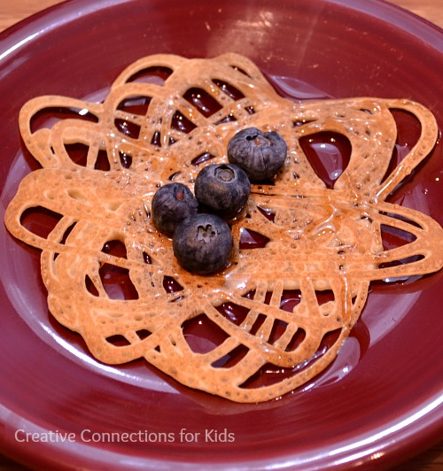 Pancake orbits with blueberries